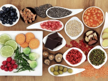 Healthy super food selection over oak wood background.